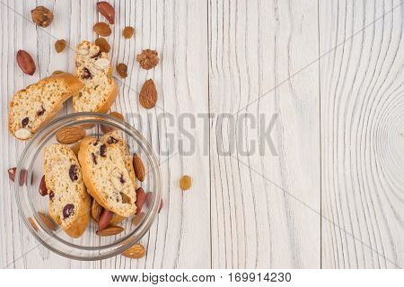 Cookies with almonds and raisins on the old wooden table. Top view.