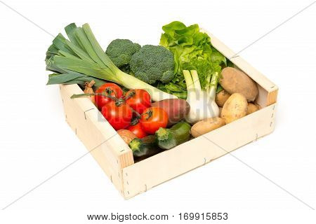 Cut Out Of Variety Of Fresh Vegetables In Wooden Crate