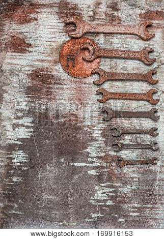 Wrenches, spanners set on old wooden table