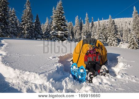 Dreaming Man In Snowshoes And Goggles Is Enjoying Relaxation