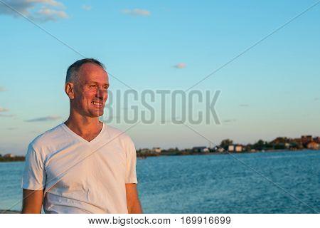 Man Enjoying Life On The Seaside