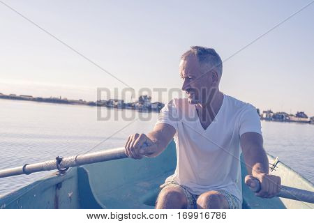 Happy Man Is Rowing On A Small Boat And Dreaming