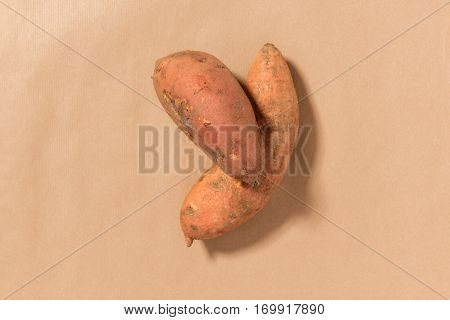 Sweet Potatoes On A Tan Background