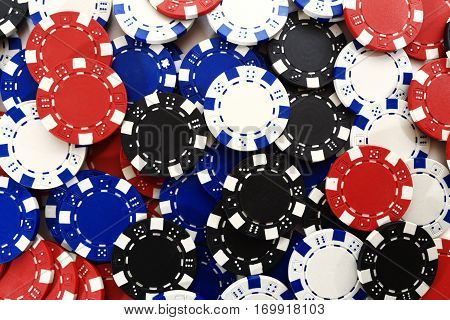 Many casino chips close up. Background of casino chips. Online casino concept.