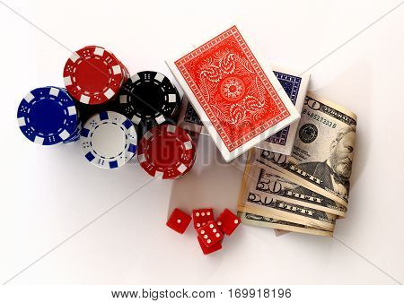 Money chips dice cards from above. Poker set from above. Close up of poker set. Casino dice chips cards money isolated on white background.