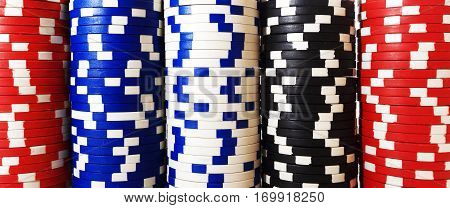 Close up columns of chips. Casino chips background. Games of chance theme.