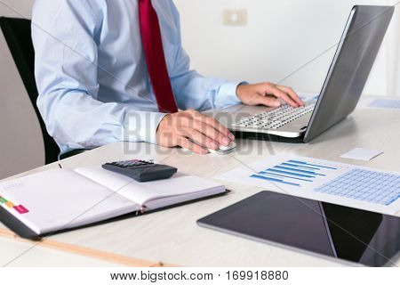 Businessman at work in his office