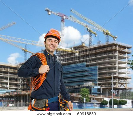 Portrait of a worker in front of a construction site