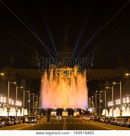 Barcelona Spain - January 06 2017: Large group of people looks at the musical fountain of Montjuic near the National Art Museum of Catalonia at night