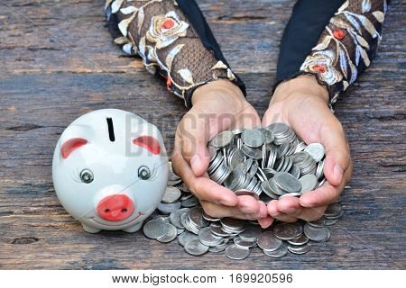 piggy bank and stack coins for saving money and success; tax season