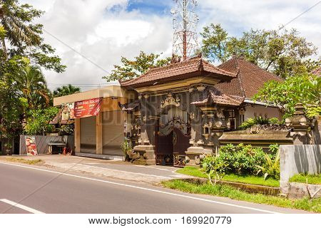 UBUD INDONESIA - January 26 2013. House with figured gate in Ubud Indonesia. Traditional asian architecture.