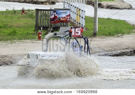 Naples Florida USA - March 3 2012: Swamp buggy churning up muddy bottom as track gets deeper