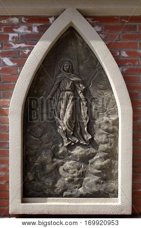 SHANGHAI - FEBRUARY 28: Assumption of the Blessed Virgin Mary into Heaven, the outer wall of the cathedral of St. Ignatius in Shanghai, China, February 28, 2016.