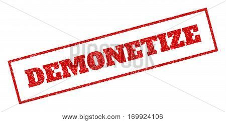 Red rubber seal stamp with Demonetize text. Vector tag inside rectangular shape. Grunge design and dirty texture for watermark labels. Inclined sign.