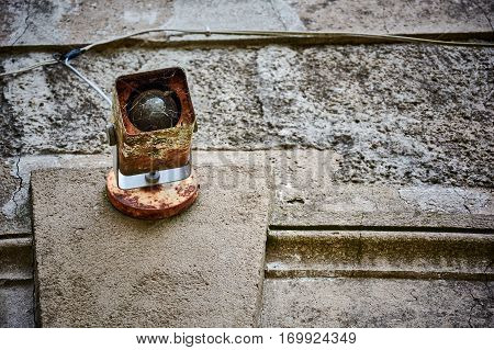 An Old Lamp In The Wall