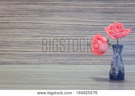 Still life vase Beautiful aster flower bouquet on wooden table background.