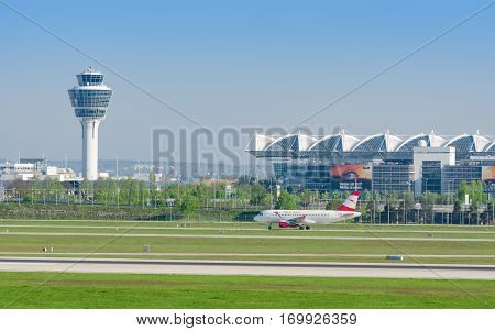 Munich Germany - May 6 2016: Munich international airport panoramic view with passenger airplane of Austrian Airlines taxiing to runway