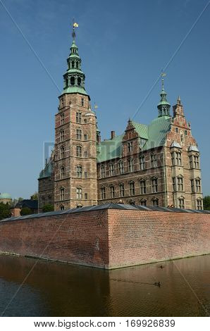 An exterior view of a castle building in the city of Copenhagen