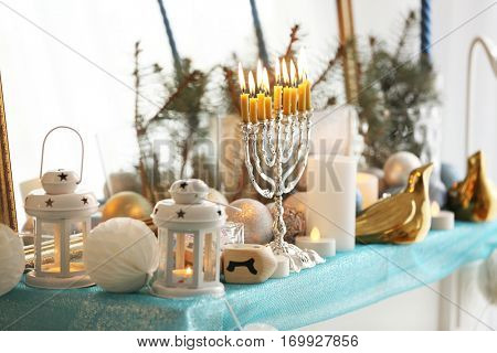Menorah and decorative elements near mirror. Hanukkah concept