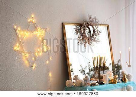 Beautiful fireplace decorated for Hanukkah