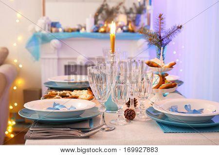 Beautiful table setting for Hanukkah in living room