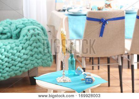 Beautiful decor for Hanukkah on stool in living room, closeup