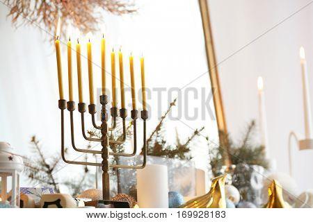 Menorah and decorative elements near mirror, closeup. Hanukkah concept