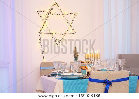 Interior of beautiful living room decorated for Hanukkah