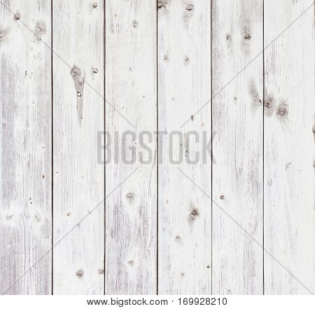Old wooden board painted white.