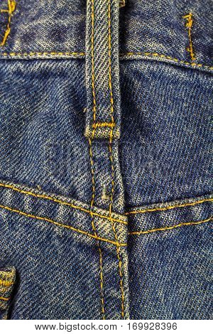 Blue jeans with seam denim texture background close up