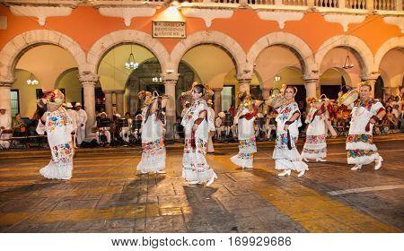 MERIDA, MEXICO-DEC 14, 2015: Women celebrating Day of the Virgin of Guadalupe (Dia de la Virgen de Guadalupe) on Dec 14, 2015 . Merida, Mexico. It is a popular Catholic feastival