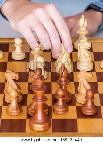 Middle Game - The Hand With Knight Makes A Move On Chess Board