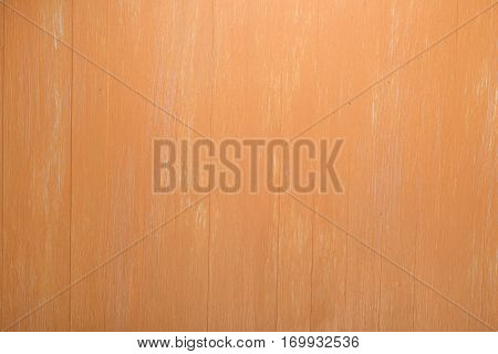 Orange wood background. Painted scraped wooden board. Bright texture or pattern. poster