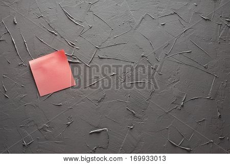 Self-adhesive Notes In Red Color On Gray Office Wall