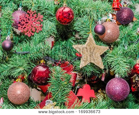 Detail Of Green Christmas (chrismas) Tree With Colored Ornaments, Globes, Stars, Santa Claus, Snowma