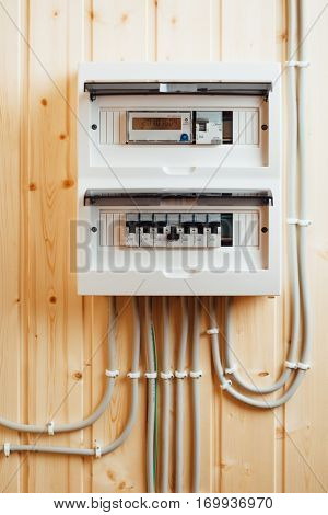 automatic fuses in electricity distribution box (fusebox) inside wooden house