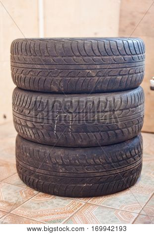 Stack of old car tire with erased tread.