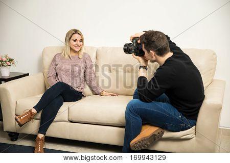 Man Taking Photos Of A Cute Girl