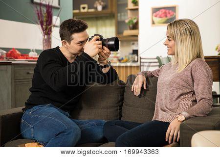 Man Taking Photos Of His Girlfriend