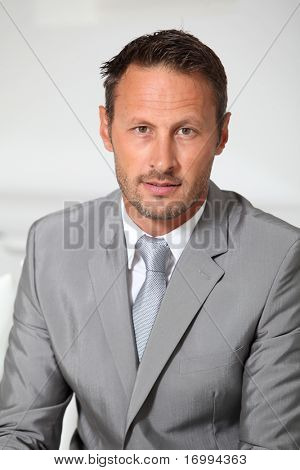 Closeup of businessman wearing grey suit