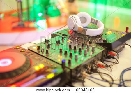 Mixing console with headphones at the night club