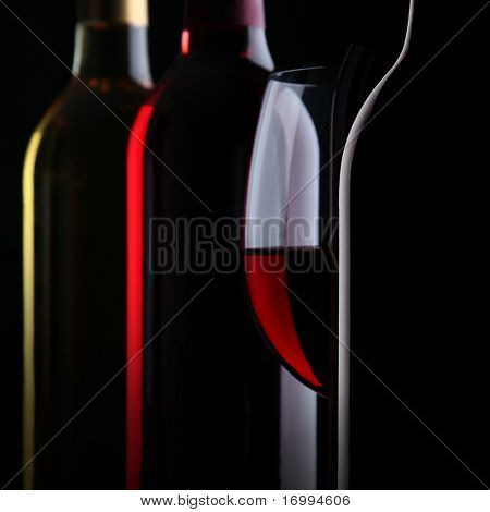 Bottles of wine on black background