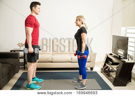 Couple Lifting Weights At Home Together