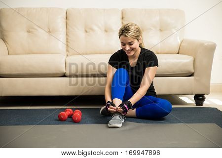 Cute Woman Getting Ready To Exercise At Home