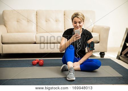 Woman Choosing A Song For Her Workout