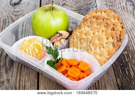Health and Fitness food in lunch box on wooden background. Studio Photo