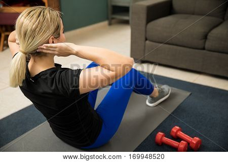 Athletic Woman Doing Crunches At Home