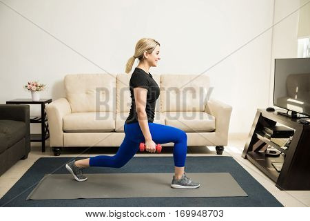 Woman Doing Kneeling Lunges At Home