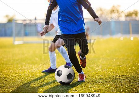 Soccer Football Players Running with Ball. Footballers Kicking Football Match on the Pitch. Young Teen Soccer Game. Youth Sports Background