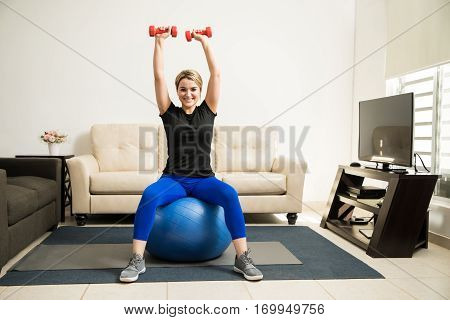Pretty Girl Lifting Weights At Home